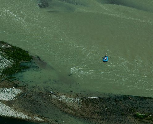 distant view of blue raft on large river