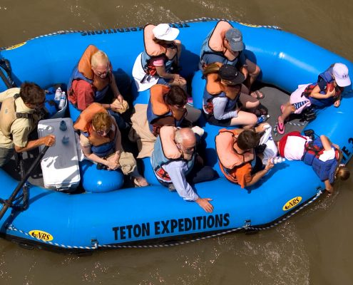 top view of group of people taking scenic float trip on river